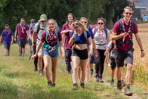 Cheerful scouts with only four miles to the finish in the 2018 Horsham Riverside Walk SUS-190325-101545001
