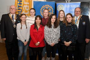 From left: Jim Randall (Rotary club of Louth, President) and Nigel Arthurs (District Governor of Rotary) with Interact members L-R Sarita Cottingham 12, Penny Chapman 12, YueYue To 18, Rosie Graham 13, Chloe Burtenshaw 13, Grace Ibbotson 12 and Grace Whitworth 17. EMN-190319-131330001