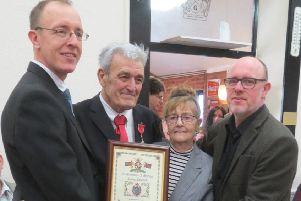 John Monk MBE alongside his wife Maureen and sons Andrew and David.