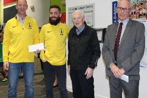Louth Triathlon Club chairman Martin Ball and club secretary Sean Hutchings (left) receive the funding from LSA's David Manders EMN-190104-180516002