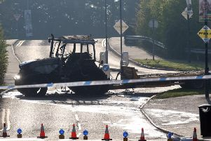 A burnt out tractor at the scene of another ATM robbery in Crumlin, Co Antrim