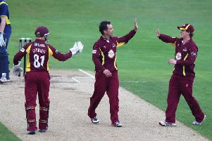 Con de Lange (centre) celebrates taking a wicket for Northants Steelbacks