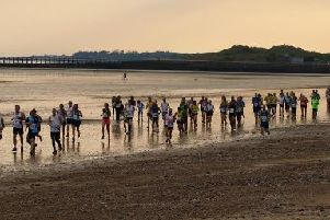 Runners take on Arunners' Beach Run