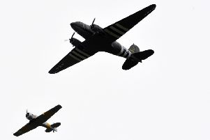 D-Day 75th Anniversary -The legendary Dakota and Douglas DC-3 aircraft fly past over Beachy Head (Photo by Jon Rigby) SUS-190606-104228001