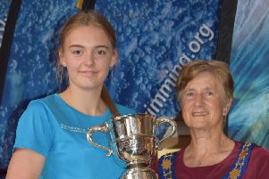 Charlotte Johnson one of her Sussex championships trophies