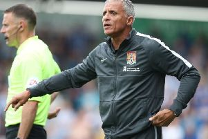 Keith Curle, minus his hat, watches on at the PTS. Picture: Pete Norton