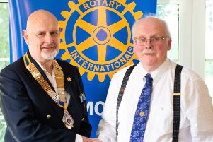 This year the new president for Louth is Richard Jones, who is seen accepting his chain of office from outgoing president Jim Randall.