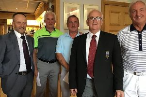 Pro-am team winners Paul Streeter (left) and team with club captain Eddie Dunkin EMN-190815-095149002
