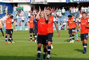 James Collins applauds the visiting faithful on Saturday