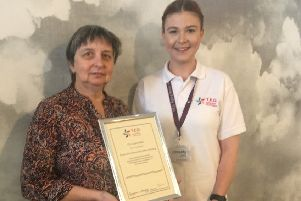 Hilary Harris, left, receiving the TED certificate by Roisin Mullee EMN-190930-115401001