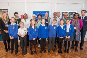 The visitors from Guadeloupe, pictured alongside staff and pupils at Grimoldby Primary School last week.
