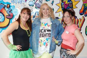Back to the 80's for (from left) Sandpiper Care Home's Registered Manager Kelly Davies, Courtney Witney and Toni Harrison.
