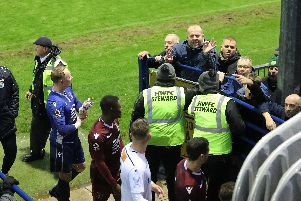 Hawks fans are not happy  - one of them gesturing a '2-0' scoreline with his fingers to Slough players after the game had been called off