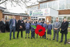 Louth Academy Armistice Day: Two minute silence and The Last Post played by ex-RAF serviceman Peter Wood from Binbrook. (Picture: Sean Spencer/Hull News & Pictures Ltd).