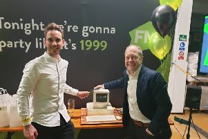 Ian Hargreaves and Shane Trail cutting the cake at First Media headquarters in Louth.
