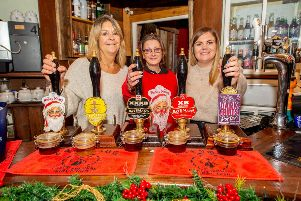 Cheers! Jackie Bateman, Sharon Leatherton Visitor Centre Staff and Anne Bauckham event organiser ready to welcome visitors to Bateman's Christmas Market. Photot: John Aron. ANL-191125-100238001