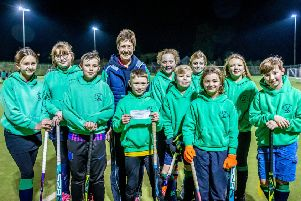 Louth Hockey Club members with the cheque.
