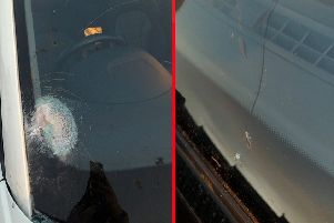 Two images of the damaged vehicle.
