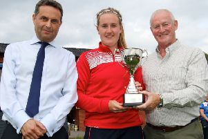 Lurgan Captain Hannah Grieve receives the Gallagher Women's Challenge Cup from Shane Matthews, Gallagher Insurance, and Clarence Hiles, NCU President. PICTURE: Ian Johnston, Cricket Europe