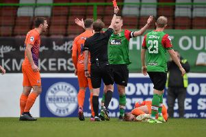 Calum Birney is sent off following a challenge on Mark Sykes.' Photo Colm Lenaghan/Pacemaker Press