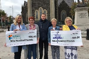 The Anderson family presenting the proceeds of their Renal Fundraiser to charity representatives from Kidney Care UK and the Northern Ireland Kidney Research Fund.  From left to right: Jo-Anne Dobson, Kathryn Anderson, Keith Anderson, Anne Hayes and Susan Kee.