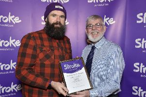 Paul McLean receiving certificate of nomination from Stroke Association committee member Peter Deazley.
