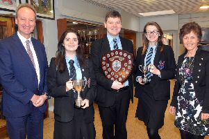 The Portadown College debating team were winners in the Northern Ireland Business and Professional Women's Debating competition for the third year in a row. In addition Joanna Kerr was awarded the prize for best chairperson and Danielle Weir received the prize for best expresser of thanks. pictured from left are Mr Simon Harper, school principal, team members, Joanna Kerr, Josh Quinn and Danielle Weir andMrs Gladys Montgomery, head of English. INPT07-201.