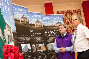 Jonathan Mattison, curator of the Museum of Orange Heritage (left), with Nigel Henderson, History Hub Ulster, viewing the Memorials to Sacrifice exhibition, which will be on display at Sloan's House in Loughgall throughout March.
