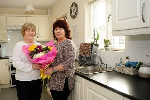 Caroline Smyth, NIHE, with Kim Hepburn in her new kitchen at 'Elm Park, Richhill.