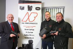 Alderman William Leathem, Chairman of the Council's Development Committee views some of the products AB Pneumatics make for Dunlop Systems & Components with Peter Blair and Jonny Boomer, co-owners of AB Pneumatics .