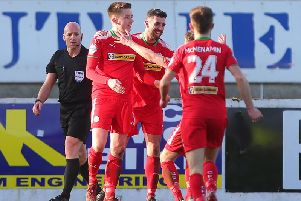 Ryan Curran (left) celebrates after scoring Cliftonville's second goal on Saturday.