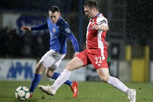 Linfield's Jamie Mulgrew and Glenavon's Aaron Harmon