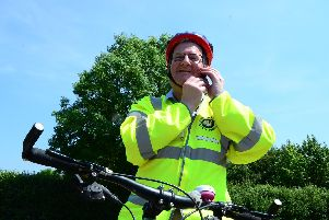 Cllr Mark Shaw, cabinet member for transport gets on his bike