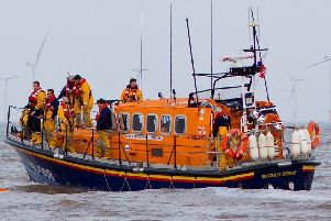 Skegness RNLI Lifeboat wqas launched to reports of a person in the water approx 200m out to sea from the beach at the boat compound at South Parade car park ANL-190321-080335001