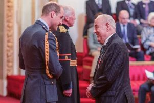 Andy Crawford receives his MBE from Prince William.