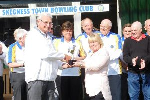 Mike Moore is pictured receiving the Barry Dennis Cup from Barry's daughter Denise.