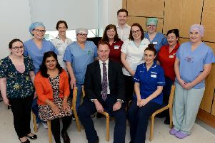 Gavin McLean (front centre) pictured with the Southern Trust multidisciplinary Team consisting of  Trauma and Orthopaedic Consultants, Anaesthetic Consultants and Registrar, Orthopaedic Theatre and Ward Nursing Staff, Clinical Orthopaedic Outcome Practitioner, Pre-op, Pharmacy and Physiotherapy staff, Pain Management Nurse.