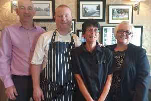 The Asburn Hotel owner Paul McConaghy, Chef Micky McLaughlin with star of ITV's The Chase Libby Magill and Susan Harbinson, head of human resources