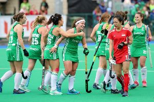 Ireland's Anna O'Flanagan celebrates scoring a goal against Singapore with team mates