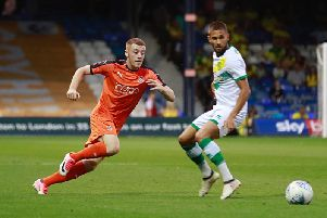Midfielder Arthur Read in action for the Hatters