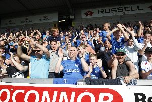 Pompey fans celebrate victory at Burton in April. Picture: Daniel Chesterton/phcimages.com
