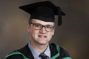 Joel Emerson pictured at his graduation. Photo by Marie Allen.