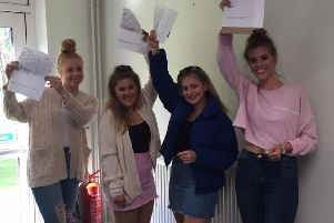 Students at King Edward VI Academy, Spilsby celebrating their A Level results.