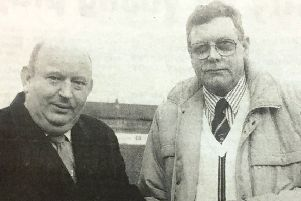 Glenavon chairman Bert Megarrell received a cheque for �2000 from Mervyn Percy on behalf of the Triangle Glenavon Supporters Club in 1992