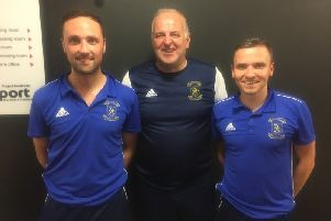 Dollingstown manager Stephen Uprichard flanked by his goalscorers against Portadown in the League Cup on Tuesday, from left, Richie Thompson and Keith Johnston.