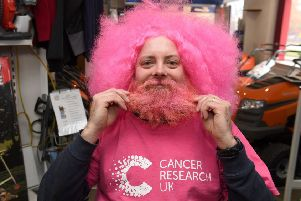 Simon Greenfield has his beard shaved off in aid of Cancer Research UK.