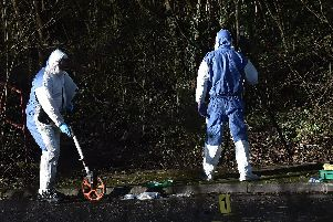 Forensic teams probe murder scene