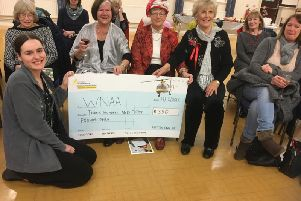 Members of the Hatton Park WI presenting a representative from the Warwickshire and Northampton Air Ambulance a cheque. Photo supplied.