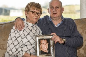 Stephen and Breege Quinn holding a picture of their murdered son Paul Quinn at their home near Cullyhanna Co. Armagh. Liam McBurney/PA Wire