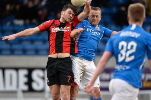 Crusaders' Philip Lowry (left) competing with Sammy Clingan of Glenavon at Mourneview Park